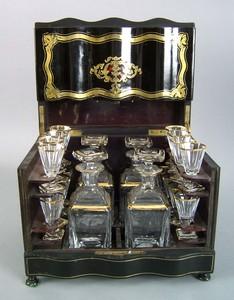 English ebonized cased liquor set, 19th c., the br