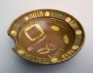 Redware barber's bowl, late 18th c., with elaborat