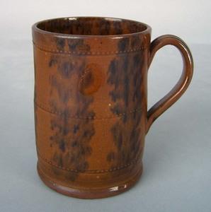 Redware mug, 19th c., with beaded bands and mangan