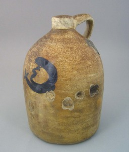 Rare man-in-the-moon stoneware jug, impressed