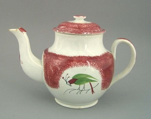 Red spatter teapot, 19th c., with parrot, 7