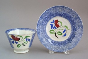 Blue spatter cup and saucer, 19th c., with pansy d