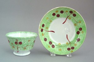 Green spatter cup and saucer, 19th c., with vine a
