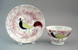Red spatter cup and saucer, 19th c., with rooster.