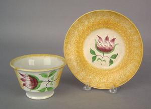 Yellow spatter cup and saucer with tulip, 19th c.