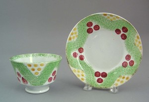 Green spatter cup and saucer, 19th c., with Christ