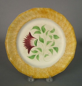 Yellow spatter plate, 19th c., with thistle, 8 3/4