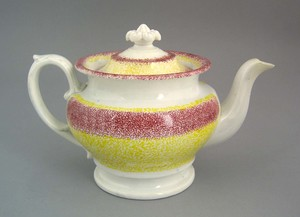 Yellow and red rainbow spatter teapot, 19th c., 6