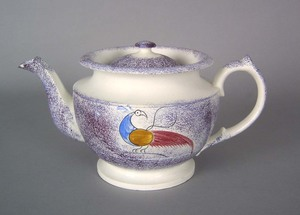 Purple spatter teapot, 19th c., with peafowl, 5 1/