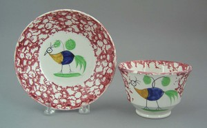 Red spongeware cup and saucer, 19th c., with babye