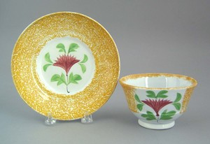 Yellow spatter cup and saucer, 19th c., with cocks