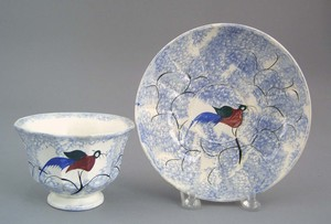 Blue spatter cup and saucer, 19th c., with goony b