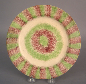 Green and red rainbow spatter bullseye plate, 19th