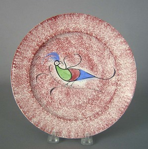 Red spatter plate, 19th c., with peafowl decoratio