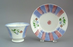 Blue and red rainbow spatter cup and saucer, 19th.