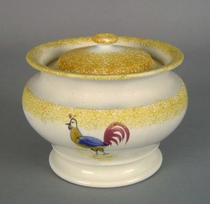 Yellow spatter covered sugar, 19th c., with rooste
