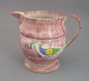Red spatter pitcher, 19th c., with peafowl decorat