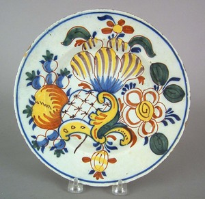 Polychrome decorated Delft plate, late 18th c., 9