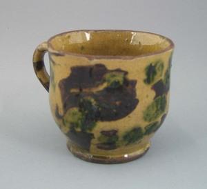Pennsylvania redware mug, 19th c., with brown andr