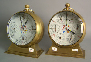 Pair of World Time brass shelf clocks in the formf