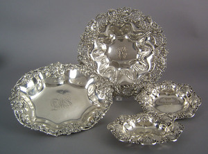 Four sterling silver serving dishes with floral de