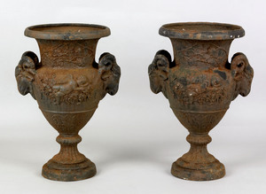Pair of cast iron garden urns, late 19th c., the b