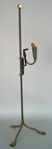 Wrought iron rush light, late 18th c., with brassi