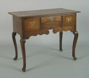 Georgian oak dressing table, mid 18th c., the rect