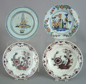 Four Delft plates, mid 18th c., with polychrome de