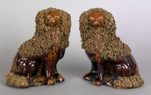 Pair of Bennington glazed spaniels, 19th c., witho
