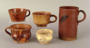 Four American redware mugs, early 19th c., 2 1/4