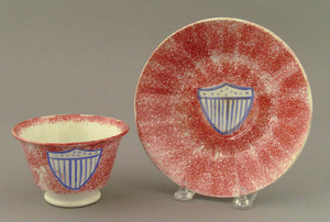 Red spatter cup and saucer, 19th c., with blue Ame