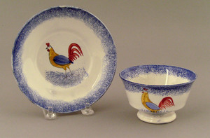 Blue spatter cup and saucer, 19th c., with rooster