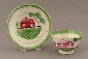 Green spatter cup and saucer, 19th c., with school