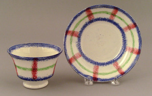 Red, blue, and green plaid spatter cup and saucer,