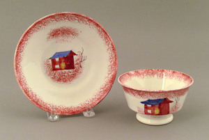 Red spatter cup and saucer, 19th c., with shed.