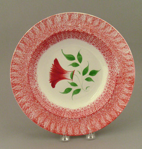 Red spatter shallow bowl, 19th c., with thistle, 1
