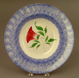 Blue spatter shallow bowl, 19th c., with thistle,