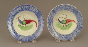 Two blue spatter cup plates, 19th c., with peafowl