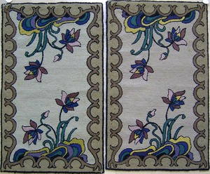Pair of floral hooked rugs, mid 20th c.