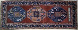 Cloudband Kazak rug dated 1906, with 3 medallionsn