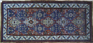 Shirvan long rug, ca. 1900, with blue and ivory me