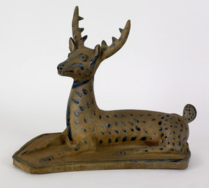 Exceptional stoneware figure of a recumbent stag,r