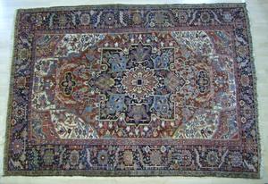 Roomsize Heriz rug, ca. 1930, 11' x 8'.