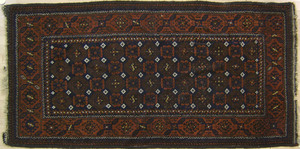 Beluch throw rug, ca. 1915, with repeating medalli