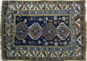Kazak throw rug, ca. 1900, with 4 medallions on aa
