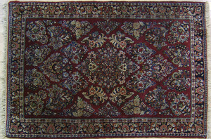 Sarouk throw rug, ca. 1930, with overall floral de