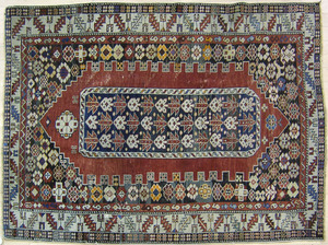 Shirvan throw rug, ca. 1910, with red medallion an