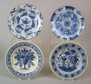 Four English blue and white delft plates, mid 18th