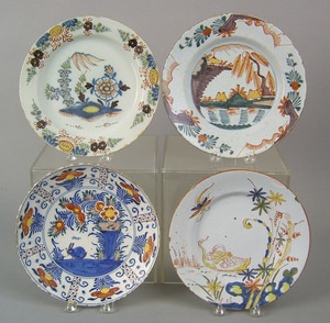 Three Dutch and one English delft polychrome plate